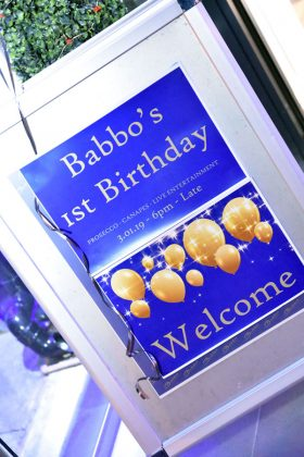 Babbo's first birthday sign